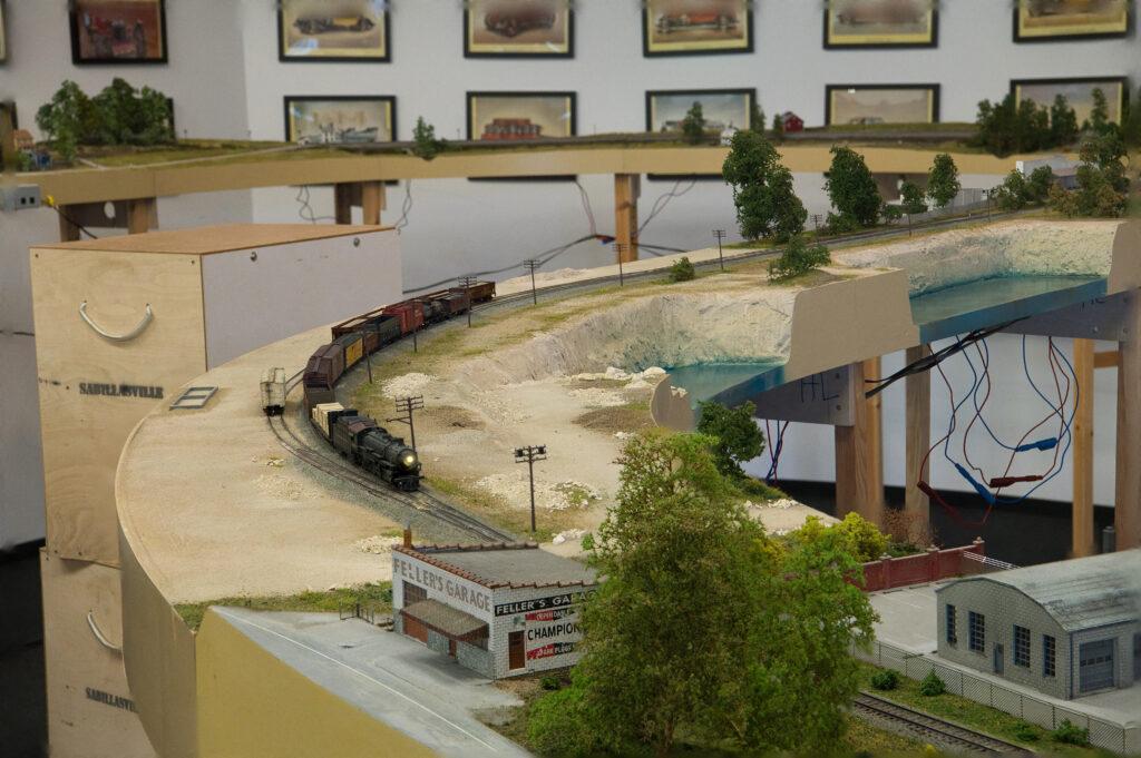 Train passing a limestone quarry